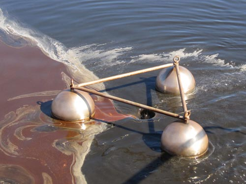 Skimmers to remove surface level oils